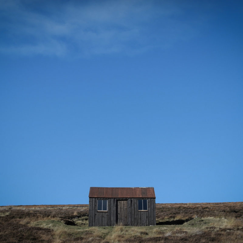 Cabrach Wooden Hut In Field